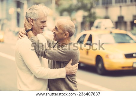 Gay Couple with Traffic on Background in New York - stock photo