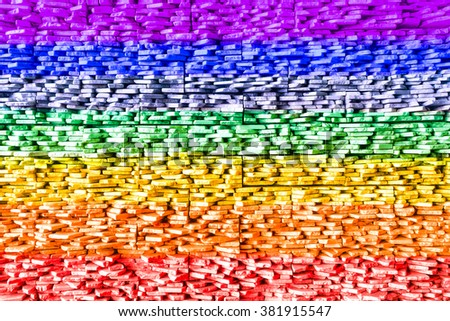Gay flag on grunge stones texture with rainbow colors - Peace flag on embossed rocks for graphic design and illustration art - Colorful architectural interior wall with vintage filter tones - - stock photo