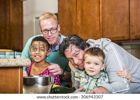 Gay with their kids in a residential kitchen - stock photo