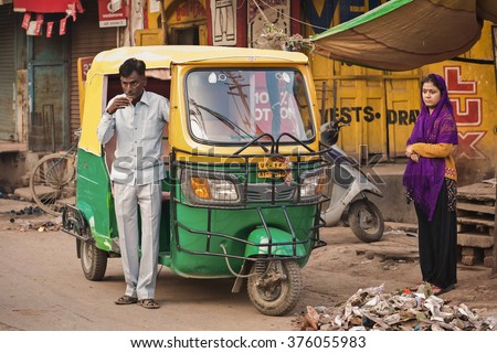 """GAYA, INDIA - JANUARY 25 2012: Indian auto rickshaws in street. Auto rickshaws (called """"autos"""" or """"tuk tuk"""") provide cheap transportation in indian cities instead of taxies for short distances  - stock photo"""