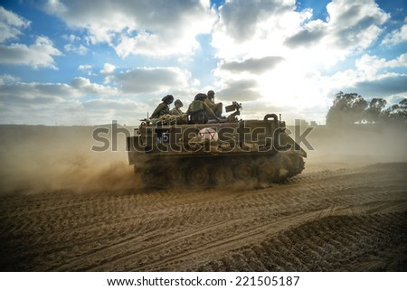 Gaza Strip/Israel -July 18 th - israeli armored personal cariier on their way into Gaza Strip in July 18th 2014 during Israel -Hamas fighting - stock photo