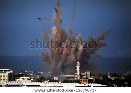 GAZA STRIP - JANUARY 14: Aerial bombing explosion in Gaza Strip during Cast Lead operation on January 14 2009. It was a three-week armed conflict in the Gaza Strip during the winter of 2008-2009. - stock photo