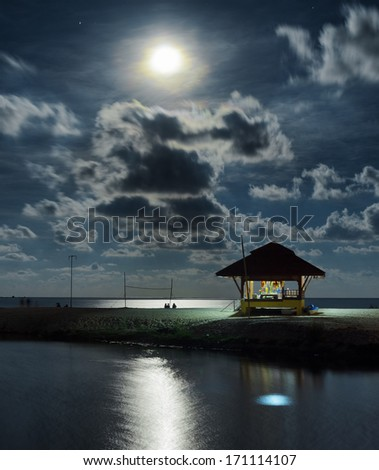 Gazebo and moon in water's reflection. Night landscape. - stock photo