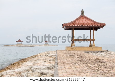 Gazebo on the tropical beach during sunrise. The island of Bali, Sanur, Indonesia - stock photo