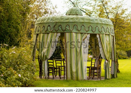 gazebo with table for eating - stock photo