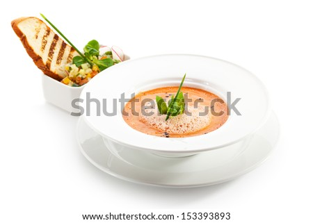 Gazpacho - Cold Tomato Soup. Garnished with Fresh Basil Leaf - stock photo