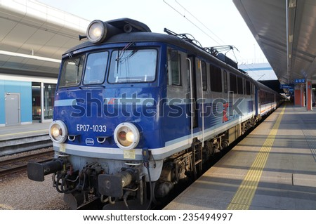 Gdansk, Poland- August 24, 2013:  Passenger express train at Gdansk station on August 24, 2013. The train is owned by PKP Intercity, the Polish largest railway operator. - stock photo