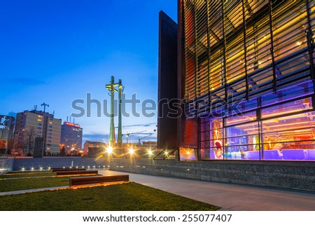 GDANSK, POLAND - FEBRUARY 21, 2015: Three crosses monument at the European Solidarity square in Gdansk, Poland. It's a memorial to the Fallen Shipyard Workers killed in 1970 at  the Lenin Shipyard.  - stock photo