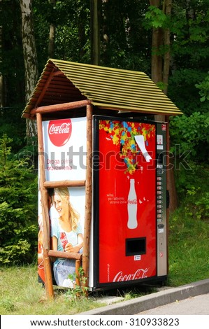 GDANSK, POLAND - JULY 28, 2015: Coca Cola vending machine on green grass at a park  - stock photo