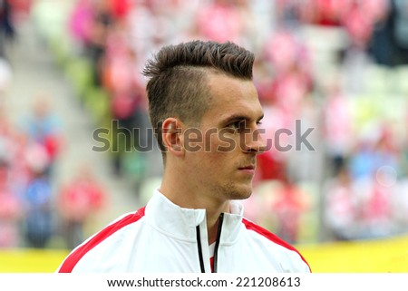 GDANSK, POLAND - JUNE 6, 2014: Arkadiusz Milik (plays as striker for Ajax Amsterdam and the Polish national team) during the friendly football match between Poland and Lithuania. Final result: 2:1  - stock photo