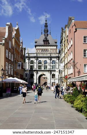 Gdansk, Poland - June 17, 2013: People on Long Lane in the Old Town of Gdansk in Poland with a view of the Golden Gate. - stock photo