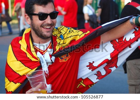 GDANSK, POLAND - JUNE 18: Spanish football fans on their way to EURO 2012 match Spain vs. Croatia on June 18, 2012 in Gdansk, Poland - stock photo