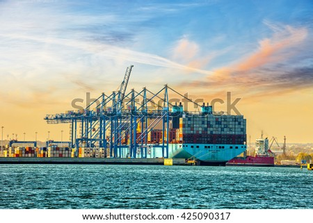 GDANSK, POLAND - MAY 7, 2016: The container ship Maersk one of the worlds largest container ship is loaded / unloaded at DCT Gdansk deep-sea terminal. - stock photo