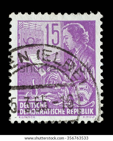 GDR - CIRCA 1953: A stamp printed in GDR (German Democratic Republic - East Germany) shows a Woman on the teletype without the inscription, from the series Workers For The Five-year Plan, circa 1953 - stock photo