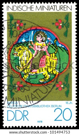 GDR - CIRCA 1979:  A stamp printed in GDR  shows Indian Miniatures, Durga,  18th cent , Berlin Museum,  series, circa 1979. - stock photo