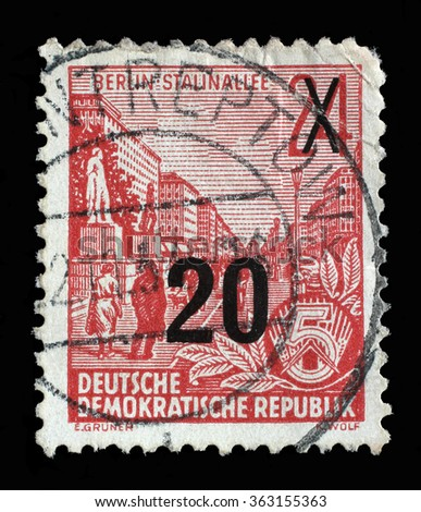 GDR - CIRCA 1955: A stamp printed in GDR, shows Stalin Avenue with inscription Berlin, Stalin Avenue, series Five-year plan, circa 1955 - stock photo