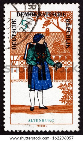 GDR - CIRCA 1966: a stamp printed in GDR shows Woman from Altenburg, Regional Costume, circa 1966 - stock photo