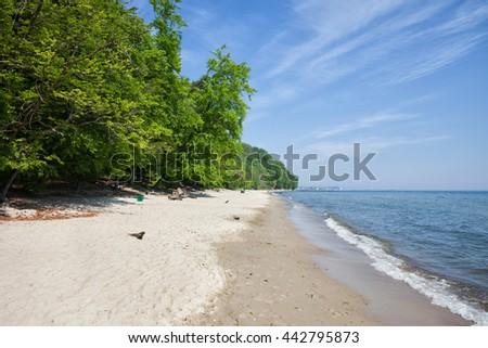 Gdynia in Poland, long white sand beach at the Baltic Sea, Kepa Redlowska natural reserve - stock photo