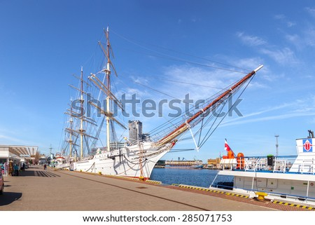 GDYNIA, POLAND - APRIL 22: People visit Polish training tall ship Dar Pomorza on April 22, 2015 in Gdynia, Poland. The sailing frigate dating back to 1909 is a famous museum ship nowadays. - stock photo