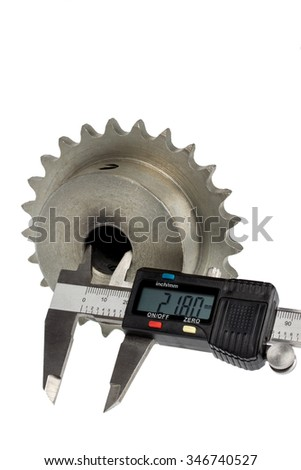 Gear and electronic caliper, on white background - stock photo