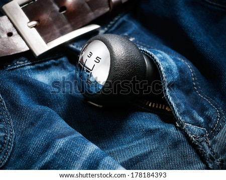 Gear shift lever in the zipper of men's jeans. - stock photo