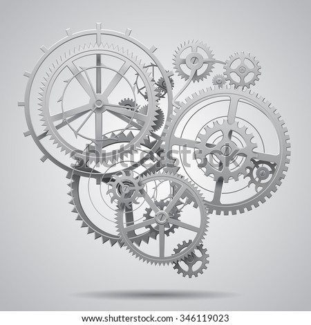 Gear wheels of clockwork in black and white on light surface. Techno background. Contains Clipping Path - stock photo