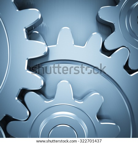 Gear wheels on metal surface - stock photo