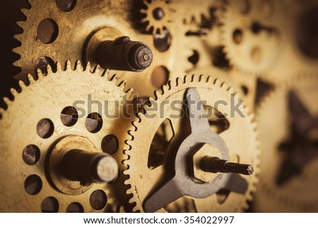 Gears and cogs macro in old mechanism - stock photo