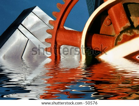 Gears and monolith - stock photo