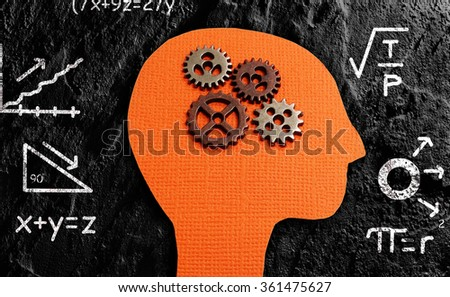 Gears and paper figure head with math formulas                               - stock photo