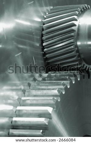 gears and titanium idea in a green metallic tone - stock photo