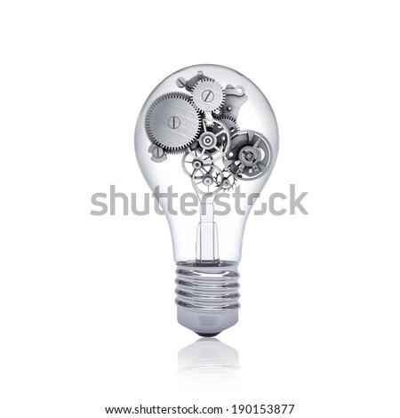 Gears inside the bulb. Concept of teamwork - stock photo