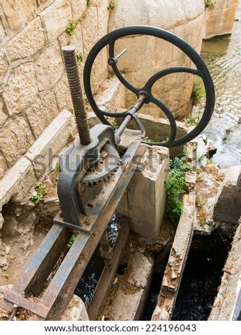 Gears of a gate irrigation - stock photo