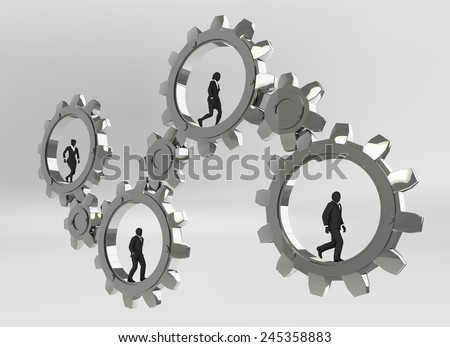 Gears of teamwork. Executives walking inside gears demonstrate the power of cooperation. - stock photo