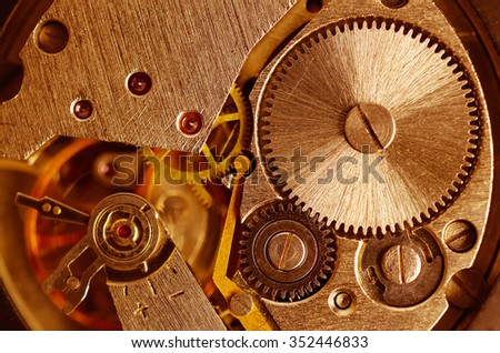 Gears old mechanical watches. Pendulum, cogs under the hood. Close up view, selective focus. Vintage toning. - stock photo