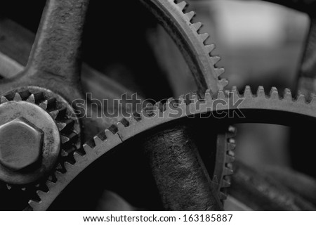 Gears on an old machine - stock photo