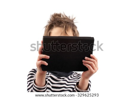 Geek boy holding a tablet device in front of him face - stock photo