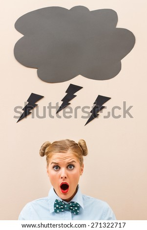 Geek girl is terrified because these days luck is not on her side.Stormy days - stock photo