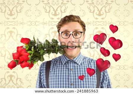 Geeky hipster biting a bunch of roses against elegant patterned wallpaper in cream tones - stock photo