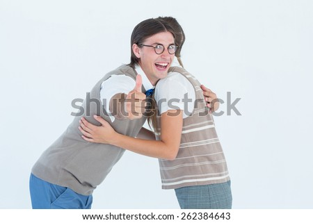 Geeky hipster couple hugging on white background - stock photo