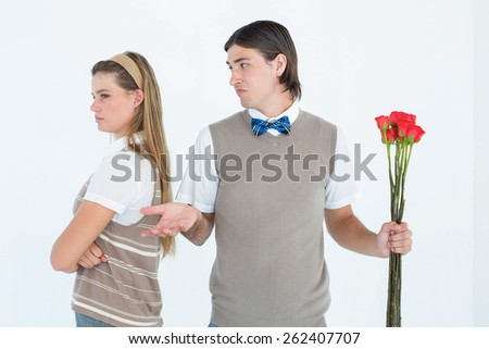 Geeky hipster couple not talking after argument on white background - stock photo