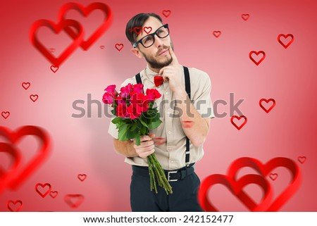 Geeky hipster offering bunch of roses against red vignette - stock photo