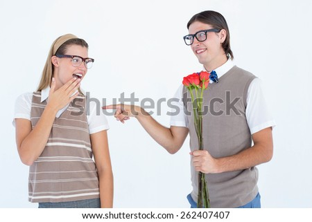 Geeky hipster offering red roses to his girlfriend on white background - stock photo