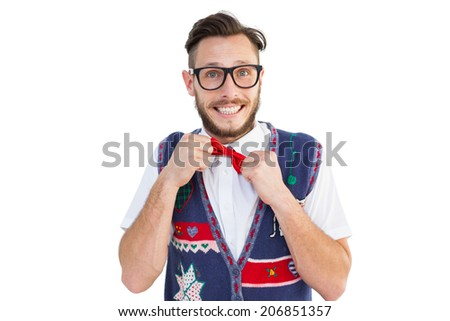 Geeky hipster wearing christmas vest on white background - stock photo