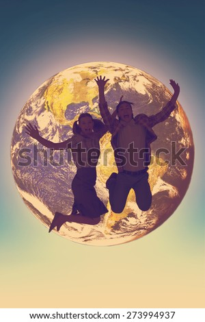 Geeky hipsters jumping and smiling against blue sky - stock photo