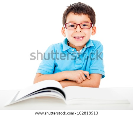 Geeky little boy studying and wearing glasses - isolated over a white background - stock photo