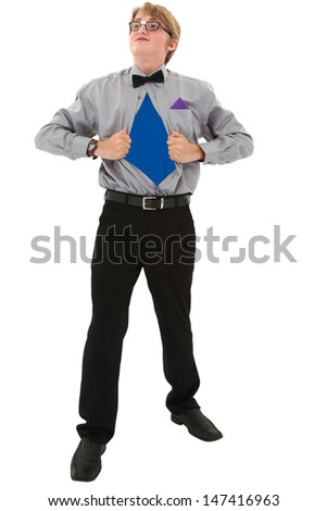Geeky teen boy ripping shirt open. Superman concept. Clipping path over white. - stock photo