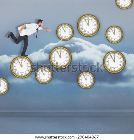 Geeky young businessman running late against clouds in a room - stock photo