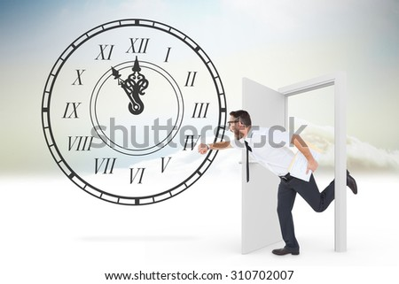 Geeky young businessman running late against open door in sky - stock photo