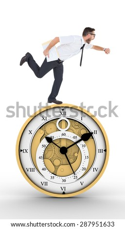 Geeky young businessman running late against pretty looking clock - stock photo